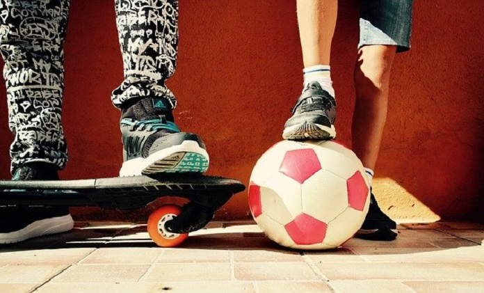 children with skateboard and soccer ball