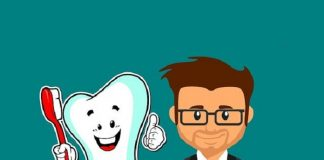 cartoon image of tooth holding a toothbrush