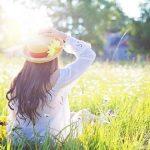 woman in a field in the sun
