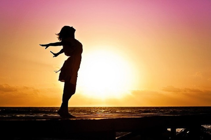 woman standing in a sunset